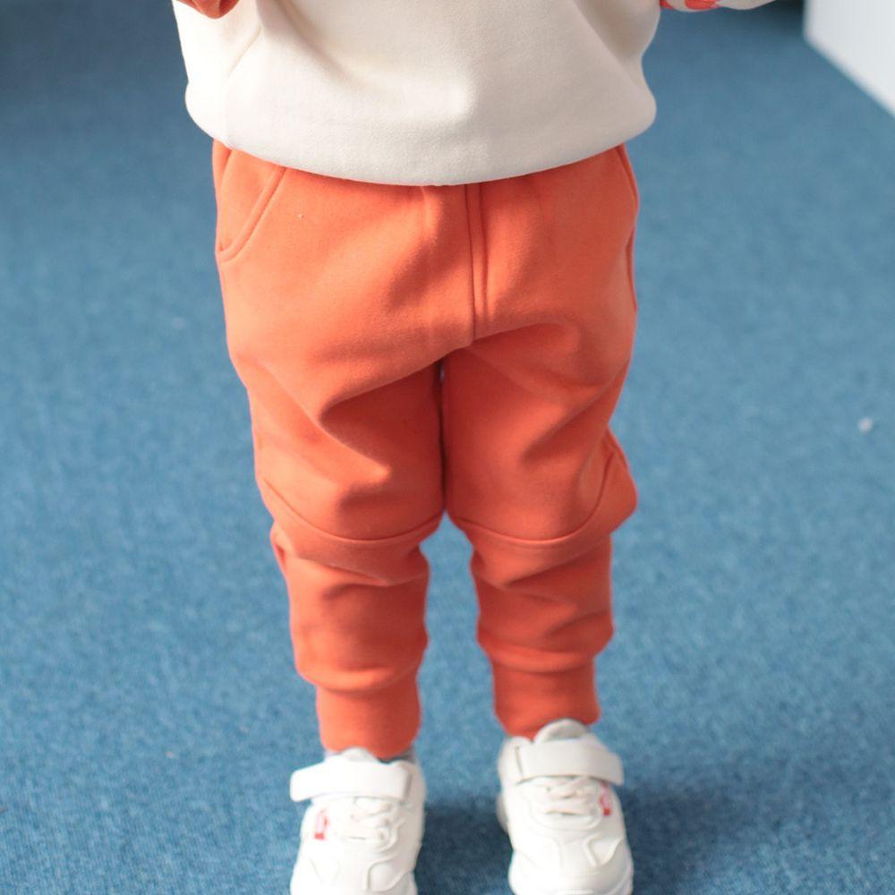 韓國 Coco Rabbit - 雙口袋縮口哈倫褲-橘