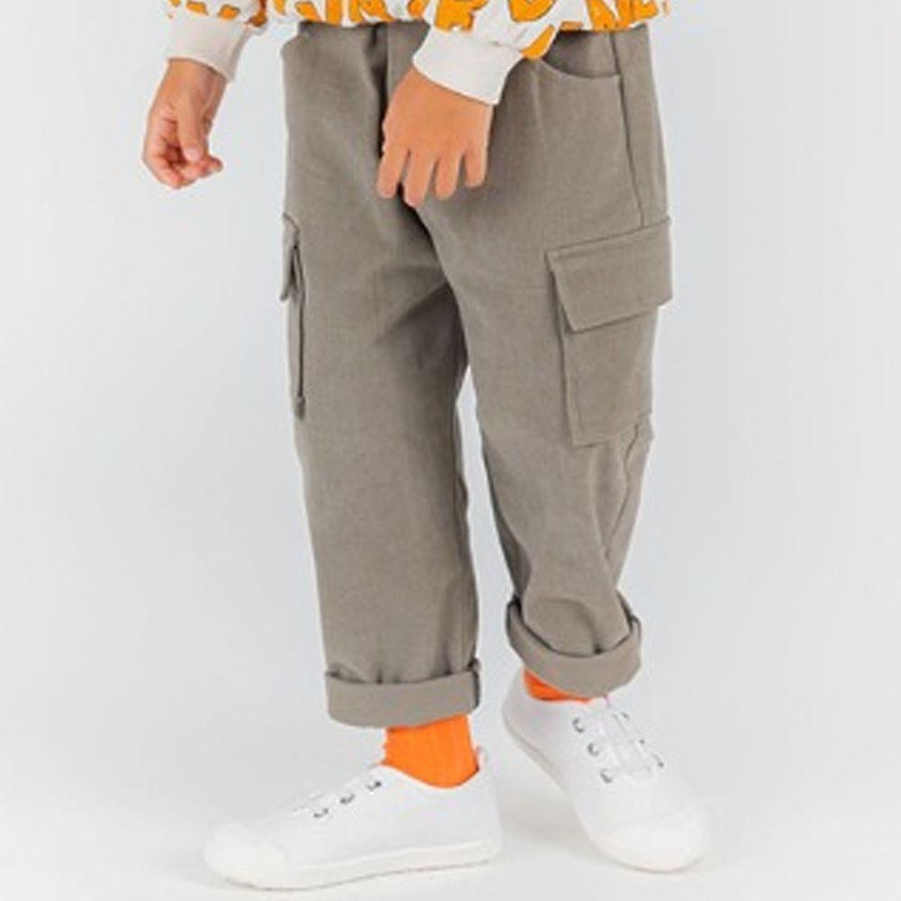 韓國 OZKIZ - 掀蓋口袋鬆緊褲頭軍裝長褲-灰杏